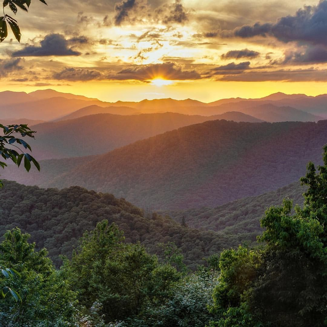 Great Smoky Mountains NationalPark in Tennessee is home to rolling mountains, old growth forests and glorious, golden sunsets. From this view on Newfound Gap Road, you can watch the sunset past Clingmans Dome, the highest point in the park. @greatsmokynps photo by Chris Mobley (www.sharetheexperience.org). #usinterior #findyourpark