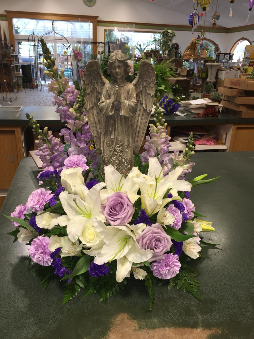 Funeral arrangement with angel funeral flowers pinterest funeral arrangement with angel izmirmasajfo