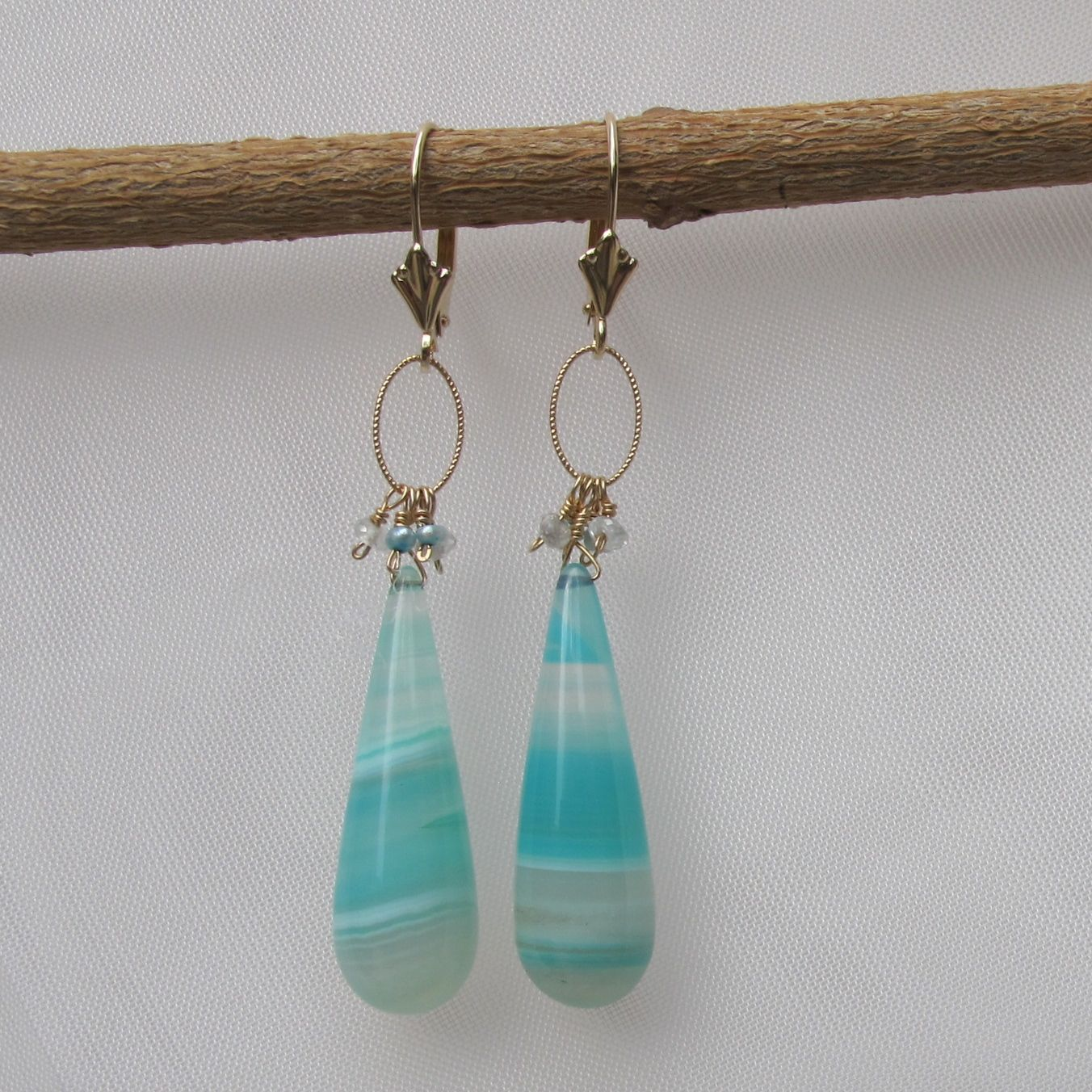 Elongated calcite drop earrings in 14K gold with pearl and aquamarine accents. 3