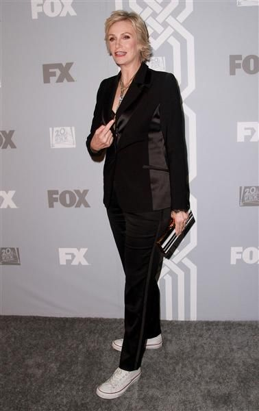 Jane Lynch changed into sneakers for the Fox Broadcasting Co., 20th Century Fox Television and FX celebration for the Emmy nominees at Soleto in Los Angeles on Sept. 22, 2013.
