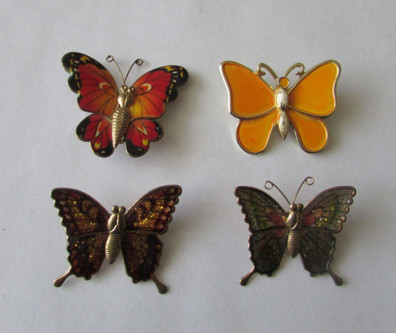 4 Vintage Butterfly Pins Brooches by MyriadOfVintage on Etsy https://www.etsy.com/listing/275355204/4-vintage-butterfly-pins-brooches