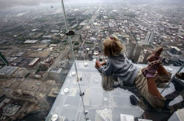 Visitors to the tallest building in the western hemisphere chicagos sears tower can now survey the windy city from glass balconies that jut out from the