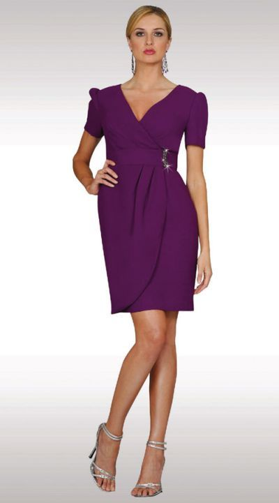 aa57989228e Short sleeve mock wrap 38 inch special occasion cocktail dress has a wide  belt with rhinestone buckle and a V neckline. Available in Plus Sizes.