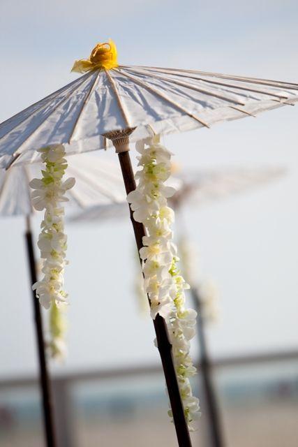 Beach umbrellas and orchids (native Hawaiian flowers). #ksadventure #kendrascott