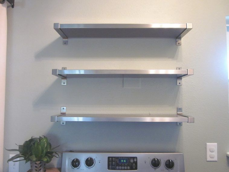 three tiers wall mounted kitchen shelves over freestanding oven