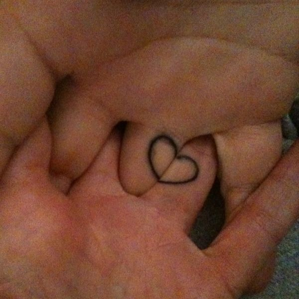 Joined heart when holding hands tattoo.