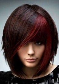 love this rich color with slices in the fringe...cute textured bob too