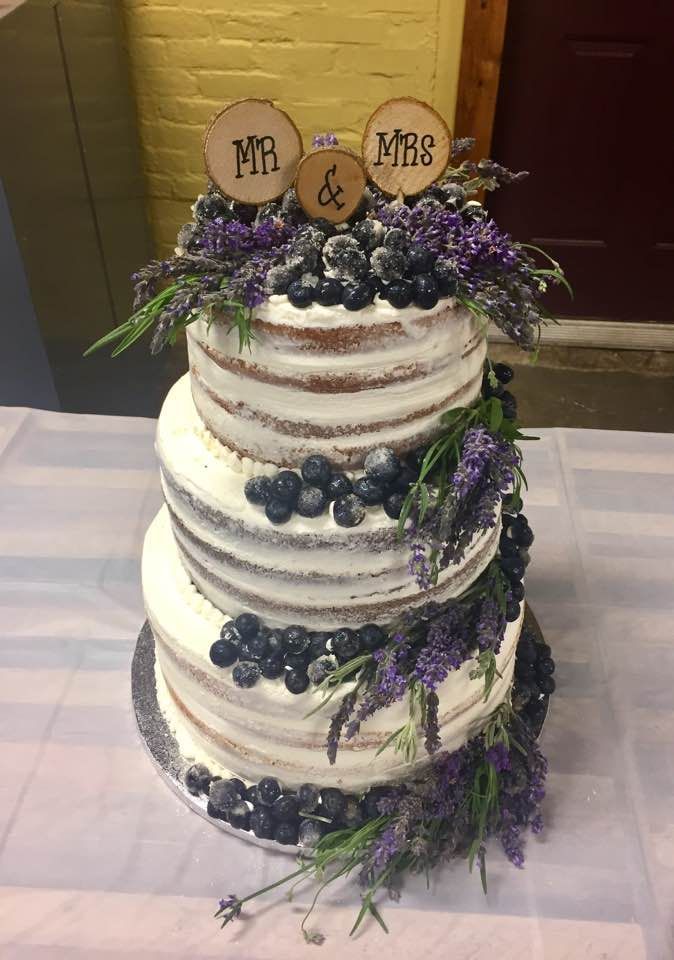 three tier naked wedding cake  decorated with fresh lavender and blueberries  with some if the
