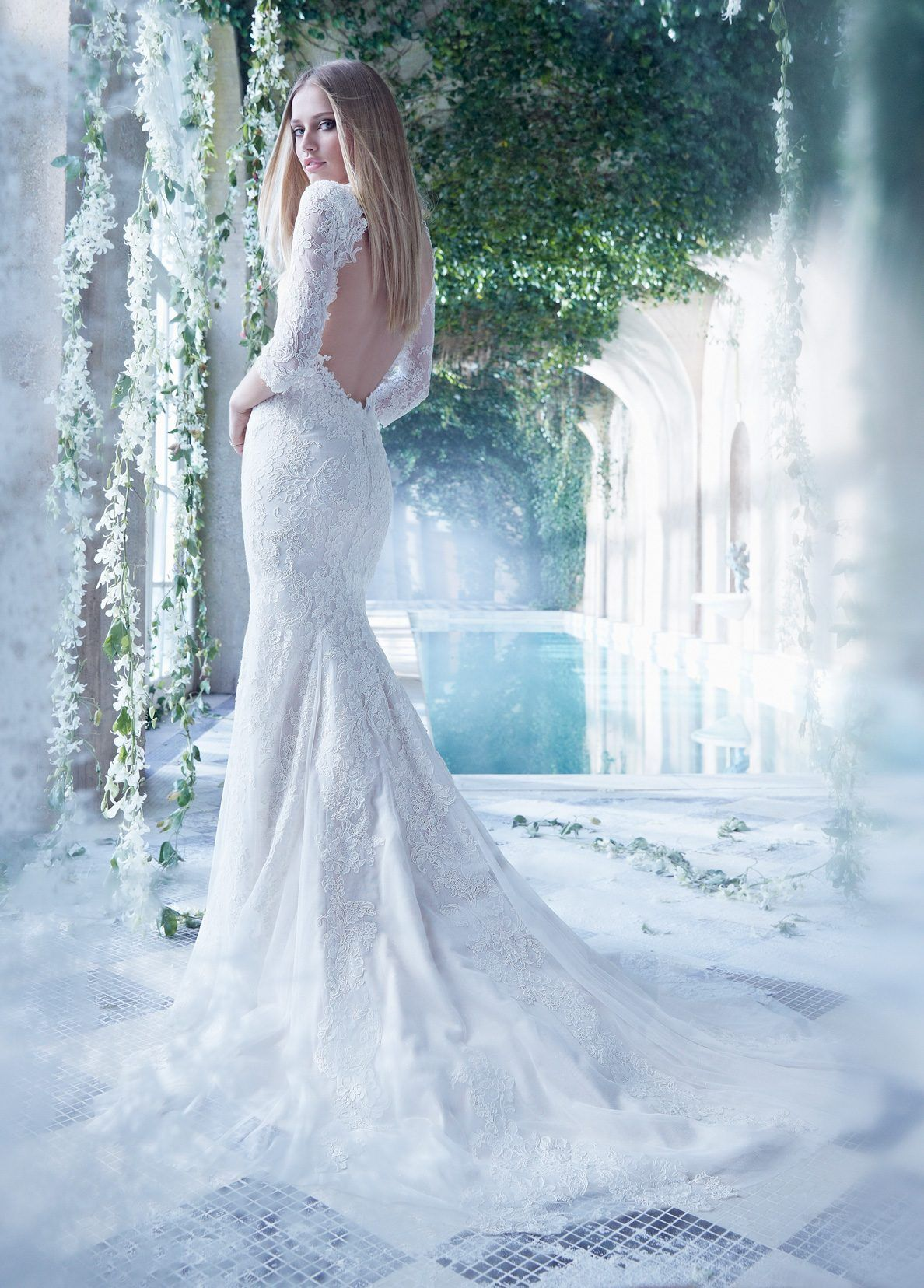 Ivory english net bridal gown with placed french alencon lace and