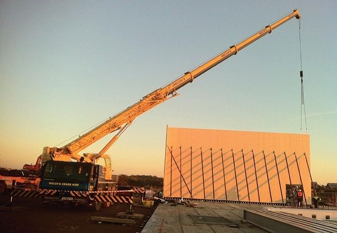 The first wall of Cambourne College, Cambridge is erected.