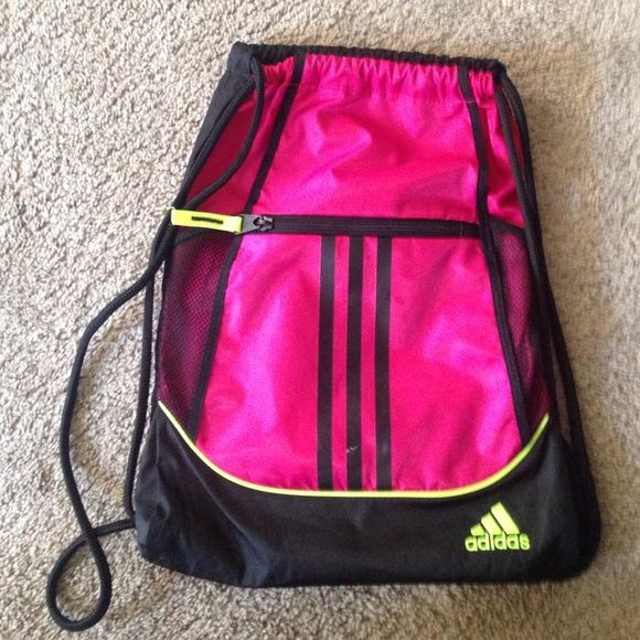 bff3281e268 Front zipper pocket along with 2 bottle holders on the side, and a  drawstrings opening. The strings are adjustable. Adidas Bags Backpacks