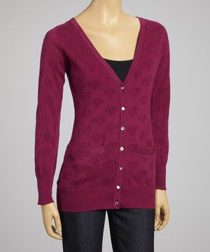 This chic cardigan is a comfortable choice for cold-weather days. Elegant diamond pointelle sets the look apart, while a button-up front keeps chilly breezes from sneaking in.