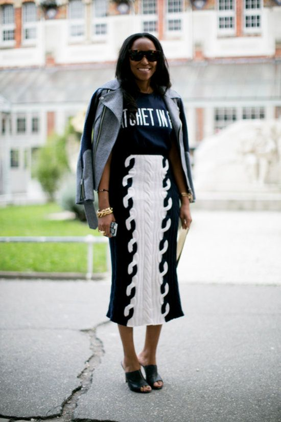 Shiona Turini's laid-back look comes with a moto jacket and a knit pencil skirt.  #pfw #streetstyle #ss14