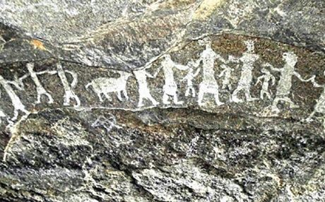 This cave painting depicts men, women and children dancing ...