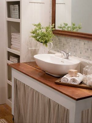 I love how an old table was repurposed as the vanity. Great look!