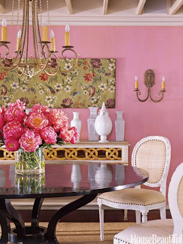 """You never think you could get away with a color this strong, but here's how. Don't paint the entire room—just one wall,"" designer Suzanne Kasler."