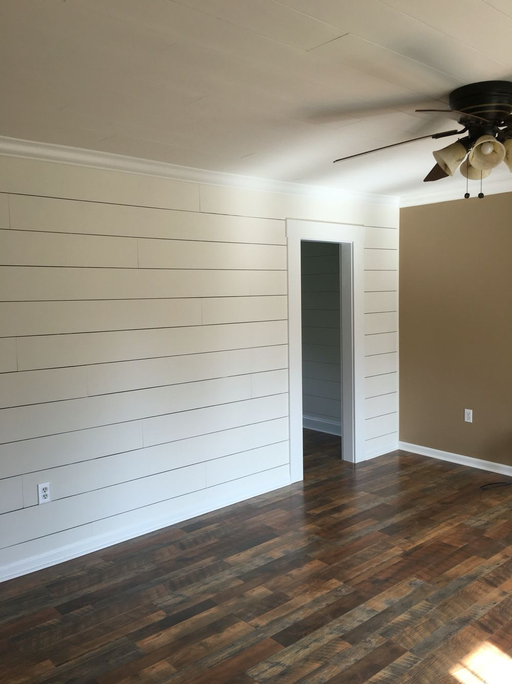Client Remodel Faux Shiplap Wall With Larger 1 8 Spacing And Pergo Max Flooring In River Road Oak Ship Lap Walls White Shiplap Wall Shiplap Accent Wall