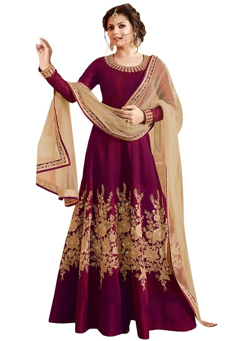 Look like beautiful Drashti Dhami in this wine art raw silk anarkali suit with zardosi floral patterns with crystals work on the lower part of the kameez and leaf embroidered patterns on neckline and sleeve cuffs. Comes with matching bottom and dupatta.