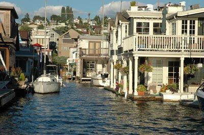 Floating Home Communities Floating Communities With Their Watery Roads And Alleyways Conjure Floating House House Boat Water House