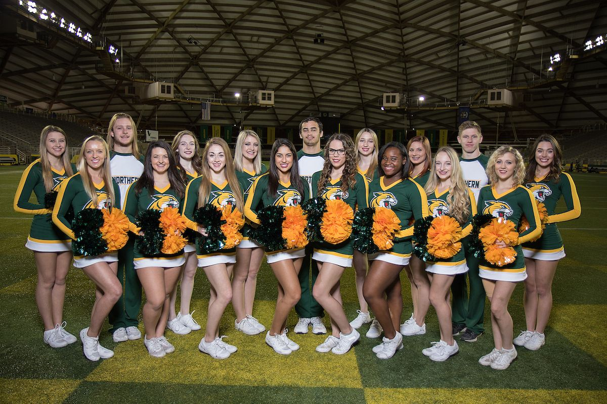 Northern Michigan University Is Home To Nearly 300 Student Organizations Including The Co Ed Cheer Team The Cheerleade Athletic Events Cheer Team Sport Event