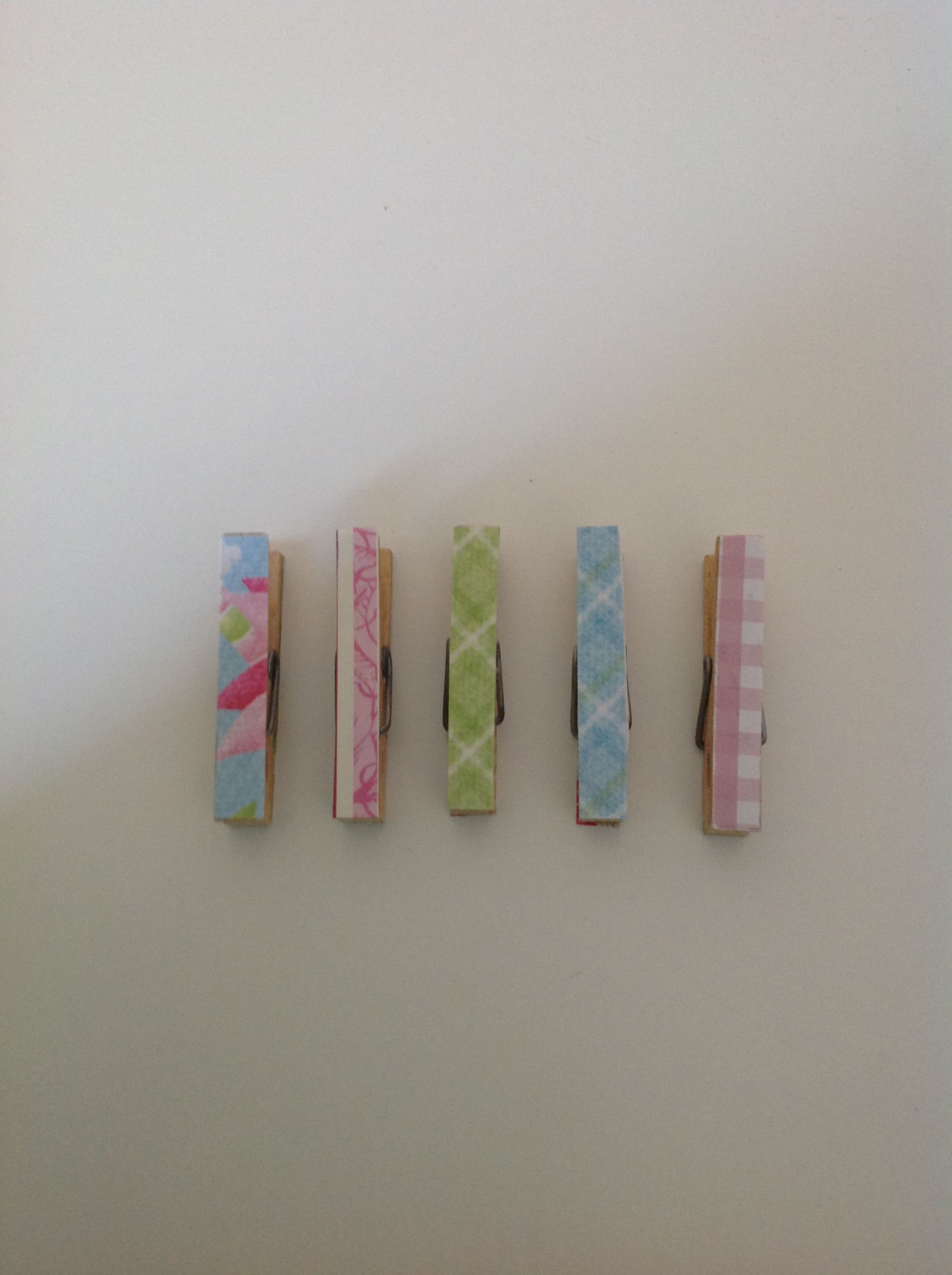 Pegs decorated with scrapbooking paper. Made by me :)