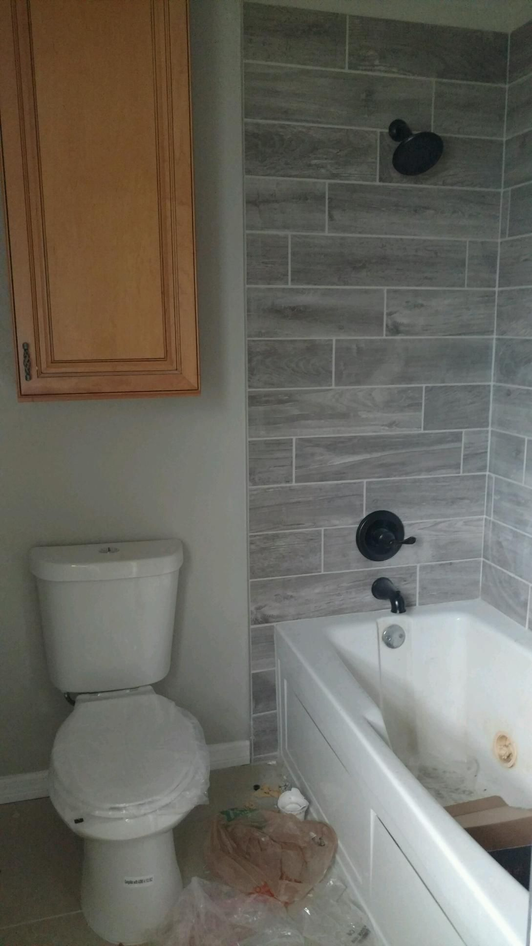 Gray Wood Plank Tile With Oil Rubbed Bronze Fixtures Wood Plank