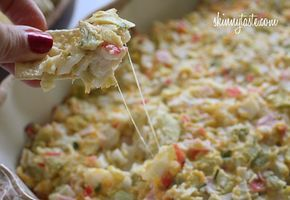 Hot and cheesy imitation crab and artichoke dip, serve this with baked chips and you have the perfect appetizer for a party.  My husband was craving an imitation crab meat salad and we made the mistake of going food shopping hungry... at a wholesale store no less, so we came home with 3 lbs of imitation crab meat!  What to do with all that imitation crab? I decided to make a hot dip with it using ingredients I had on hand.     I can see using a good light Swiss, such as Jarlsburg or a light…
