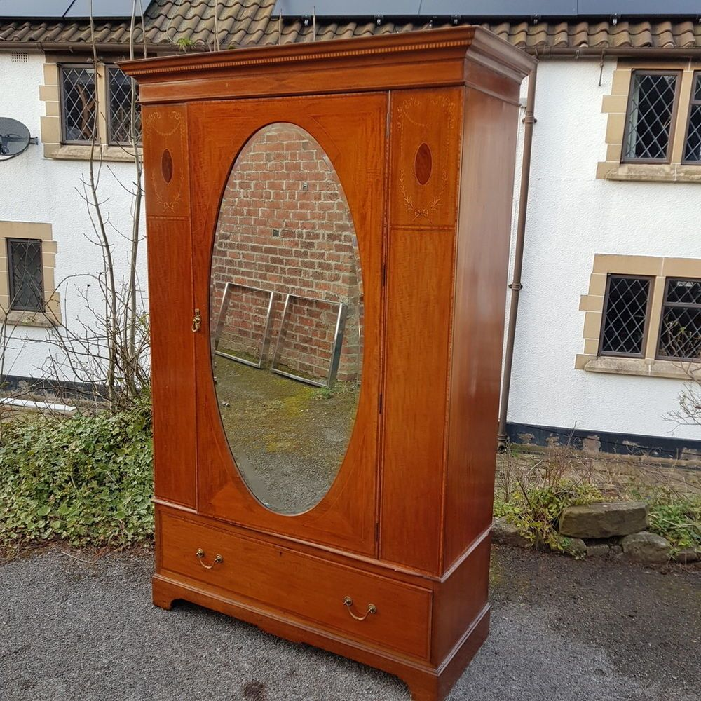 A beautiful antique edwardian wardrobe with inlaid detail