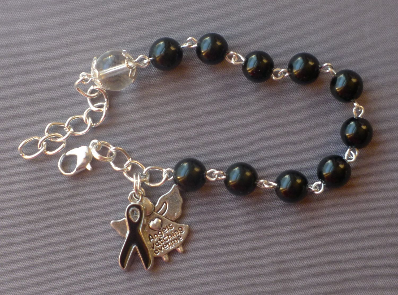 Melanoma (Cancer) Awareness - 8mm Black Glass One Decade Rosary Bracelet by JaysReligiousGifts on Etsy