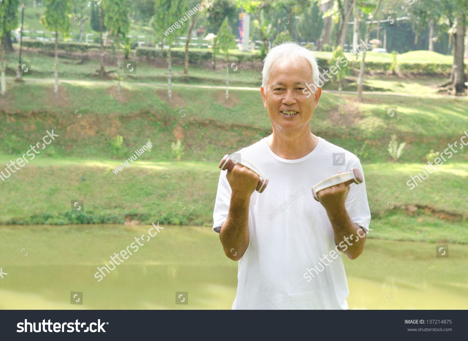 chinese Asian senior man healthy lifestyle working out on a park with a dumbbell #Ad , #Ad, #senior#man#chinese#Asian