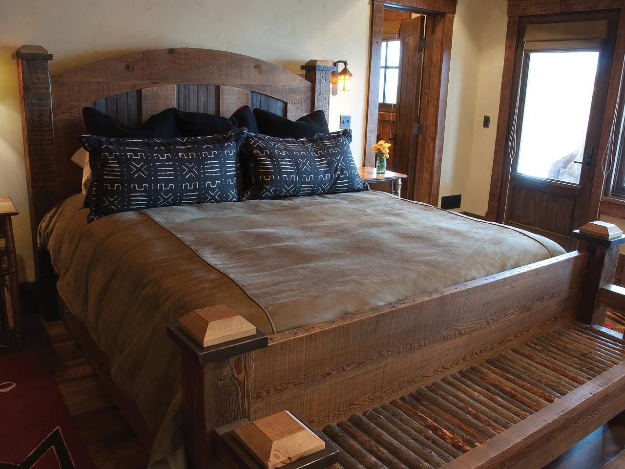 A custom king bed made from historic materials anchors