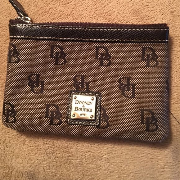 Dooney & Burke pouch!! Perfect to grab an go!!..only used a few times!!...perfect pouch to hold coins or credit cards in!!..in perfect condition!! Dooney & Bourke Bags Clutches & Wristlets