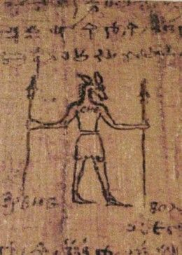 Notice that although the papyrus is written in Greek, it here clearly depicts a man with the head of an animal and holding two wands or staffs. This holds true with traditional depictions of Egyptian gods - wands and staffs were symbols of power.