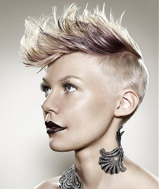 A short blonde straight coloured spikey quiff shaved ...