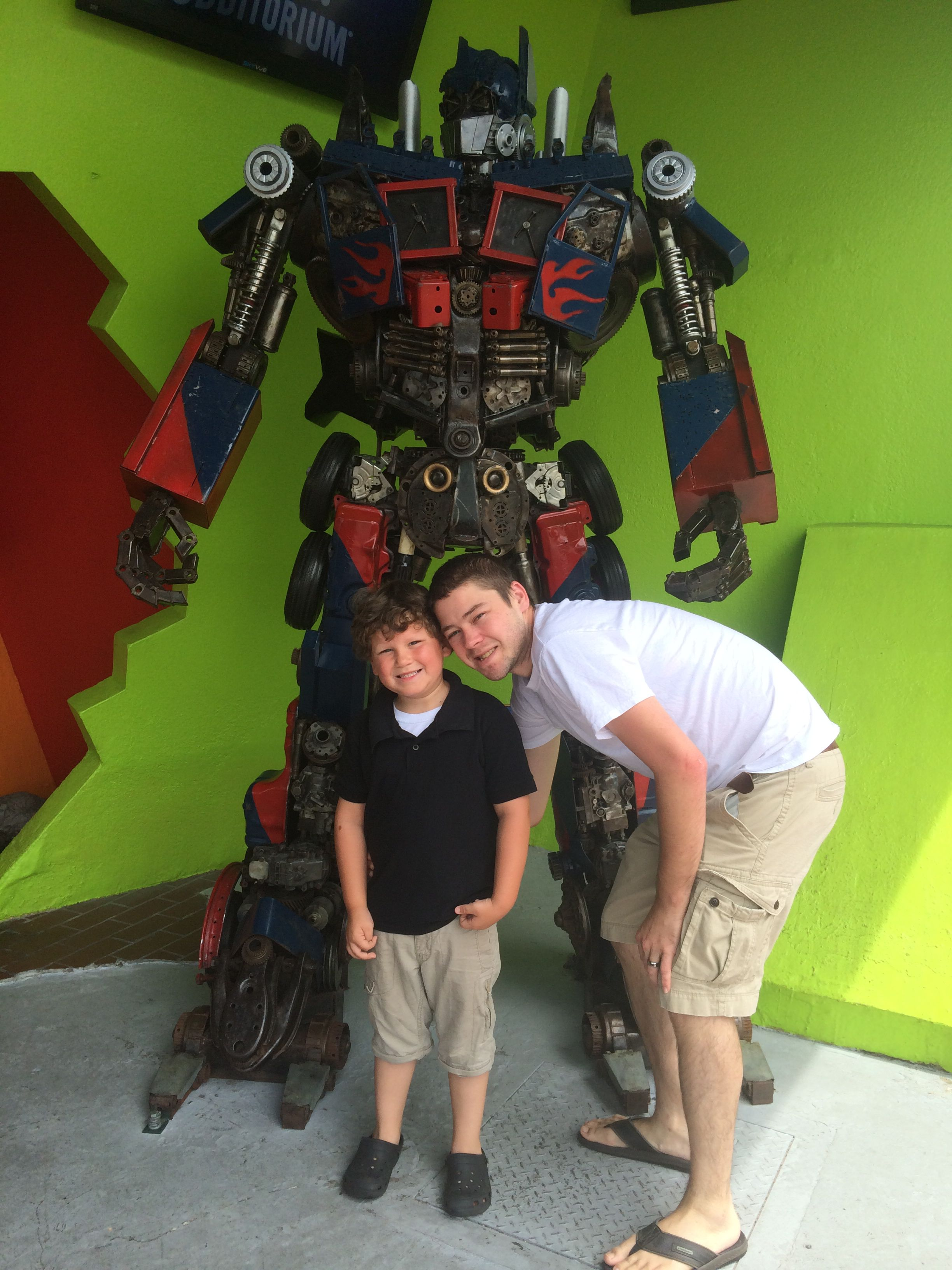 "Daddy, Mikey and ""captain crime"" Optimus prime."