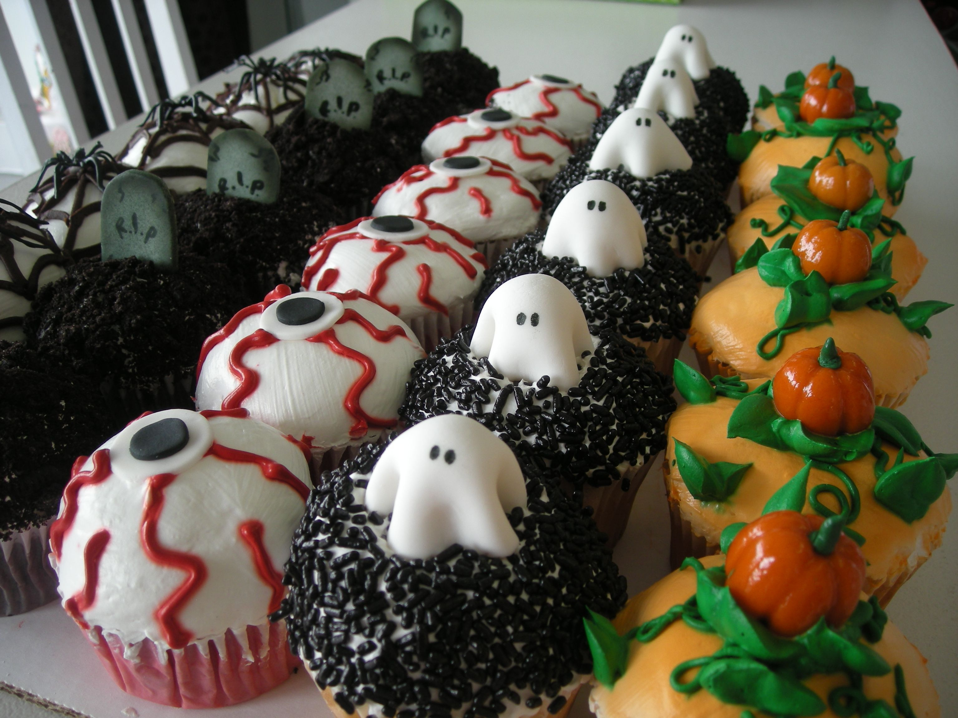 a collection of great and creative halloween cupcake ideas for baking fans