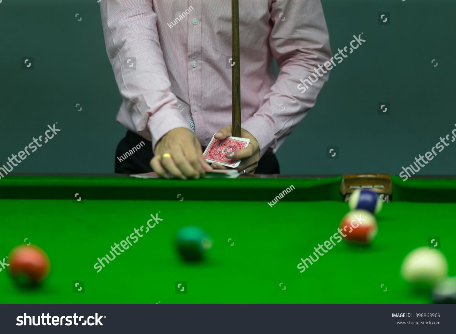 snooker player drawing card for gamble in pool sport Ad