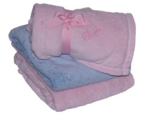 The micro fleece blanket is made of 100% ultrasoft and plush polyester fleece and is the perfect size for taking along on any journey. This blanket is available in pink or blue and can be embroidered with baby's name or initials in one corner. Measures 30