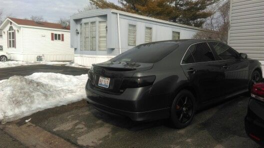 2009 toyota camry black out! Vht night shades on taillights. Spolier painted black with wheels.