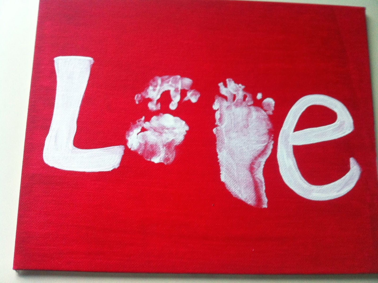 hand print and footprint DIY valentines day craft. Love sign ...