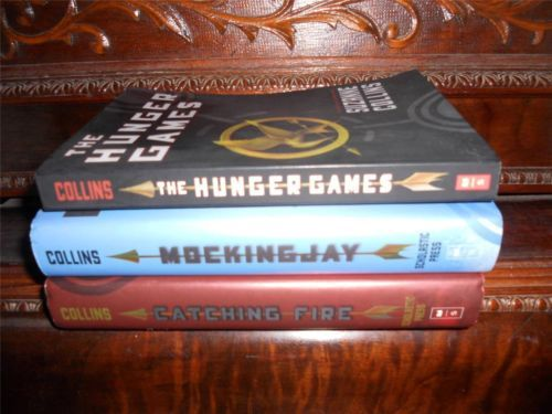 The Hunger Games trilogy by Suzanne Collins, vol. 1-2-3