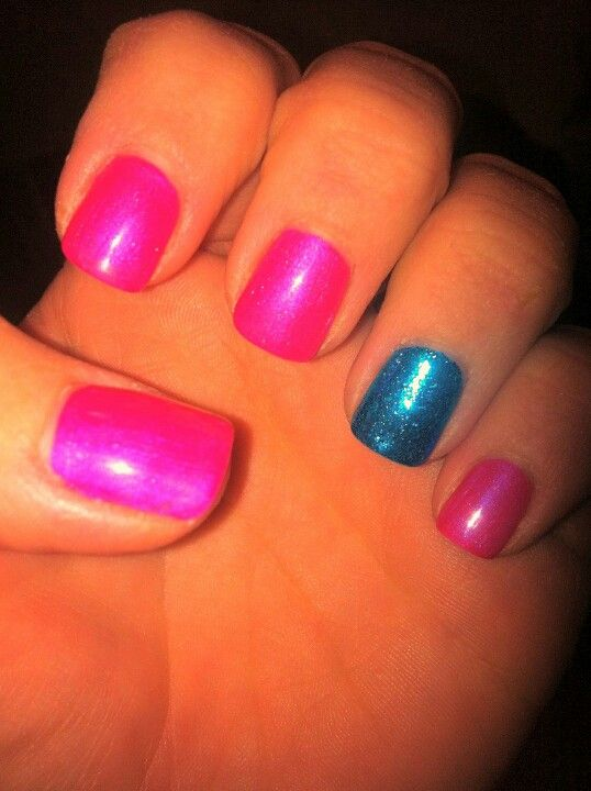 Pink shellac and blue rock star accent nail.