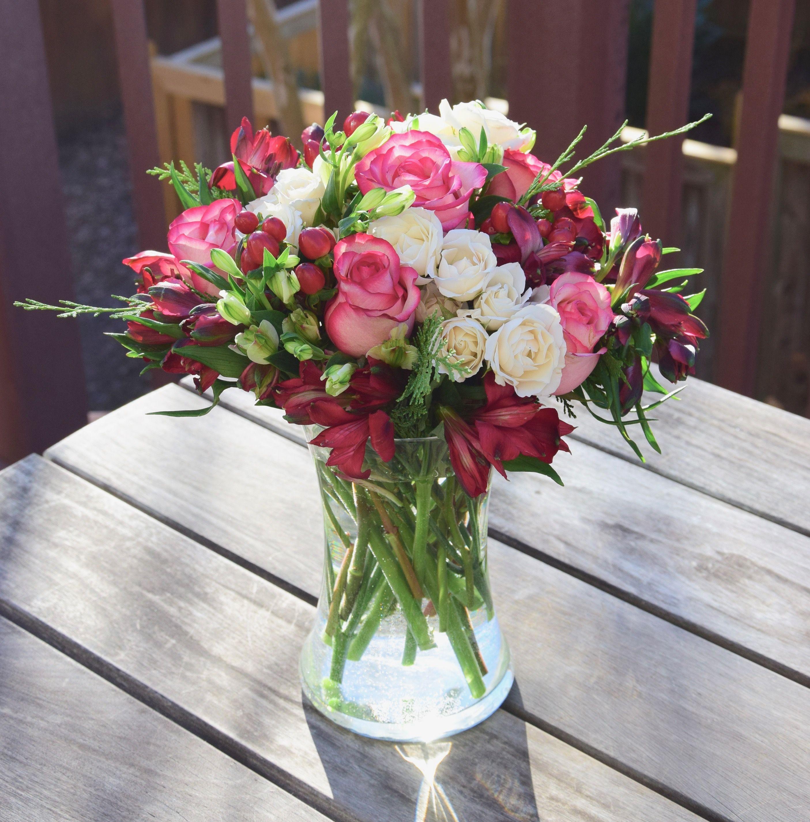 Fresh Flowers In A Vase Alstroemeria Roses Spray Roses And Hypericum Berry Fresh Flowers Arrangements Flower Arrangements Rose Arrangements