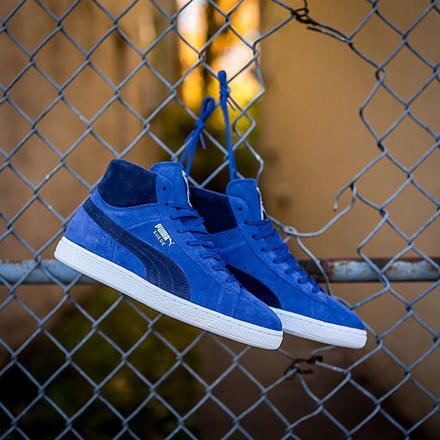 The mid top edition of the Puma Suede is hitting shops in a series of  colorways this season.