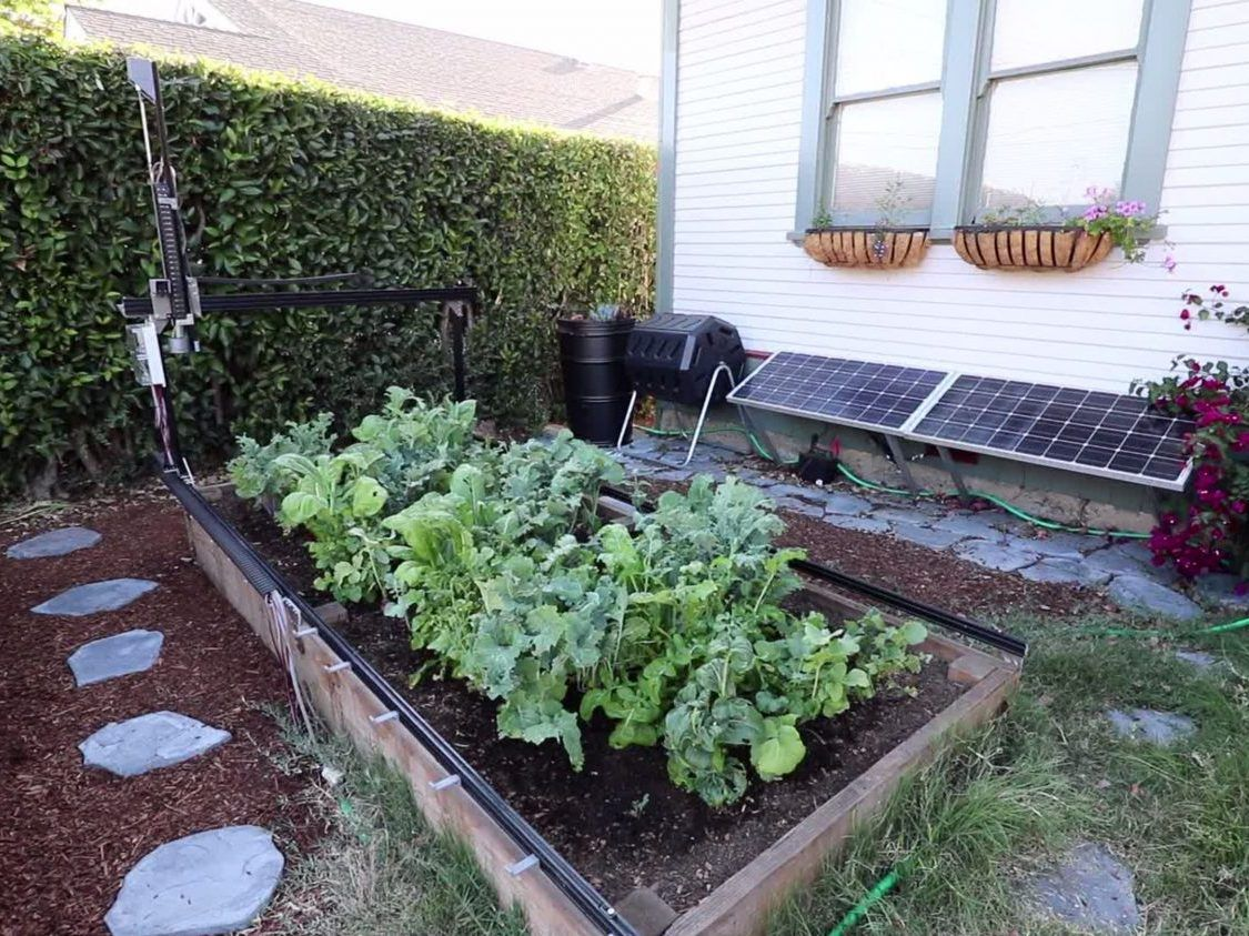 this farmbot plants your seeds waters your plants and pulls