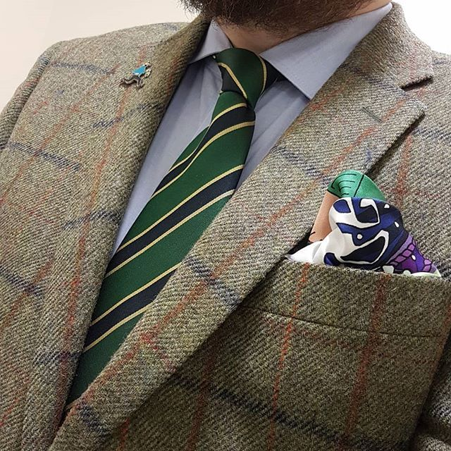 c0e7ef0f967d Recharge your suits and blazers with this sensationally handsome British tie  with regimental stripes in dark green, navy blue and gold.