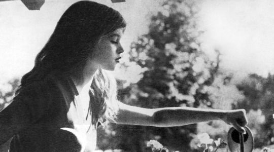 Rare photo of Brigitte watering the flowers in Louveciennes. Photographed by Walter Carone c.1952