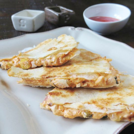 Buffalo Chicken Quesadillas - Best football game party food EVER! Budget-Friendly and SO addictive.  From the Pretty/Hungry Blog.