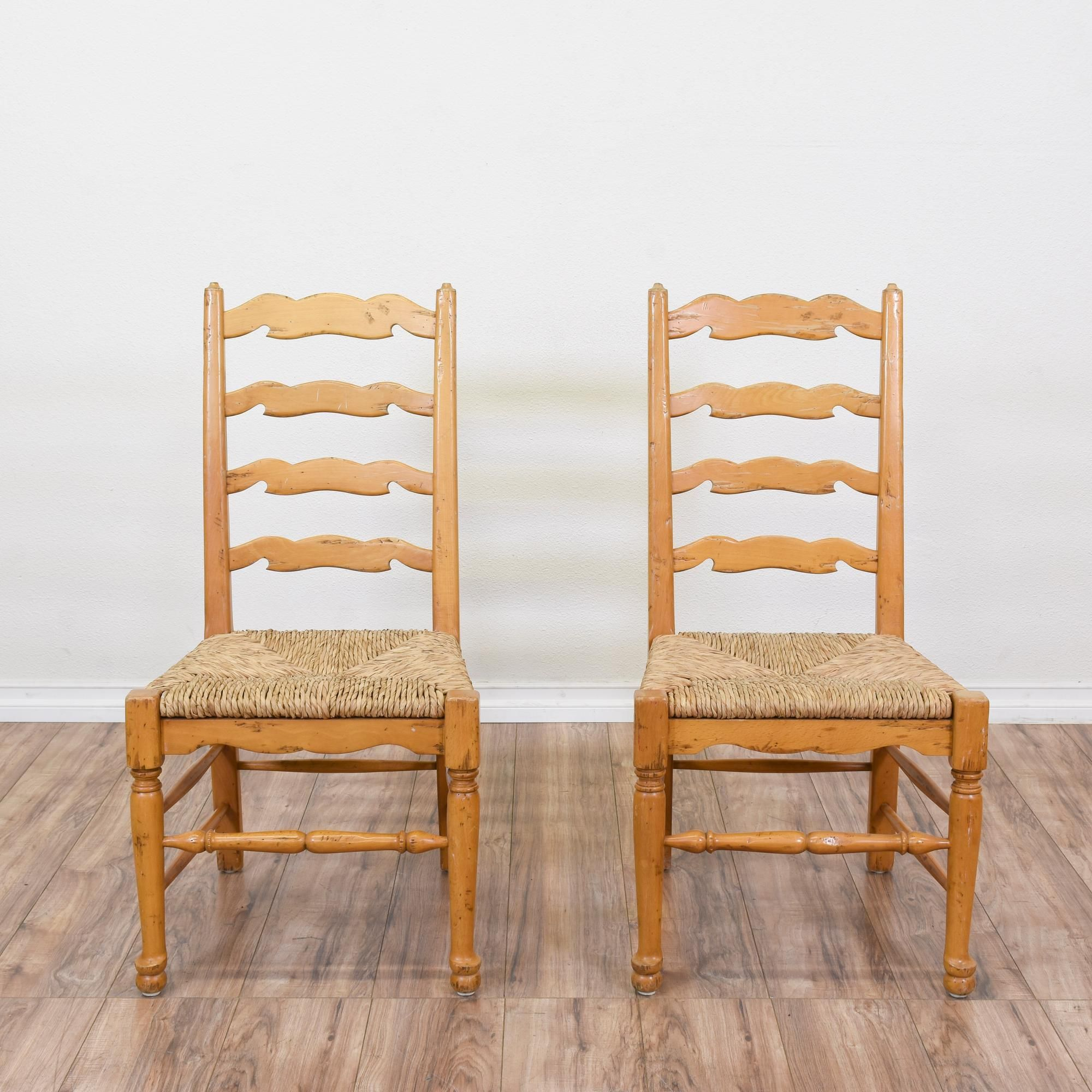 This Pair Of Ladder Back Chairs Are Featured In A Solid Wood With A Light  Blonde