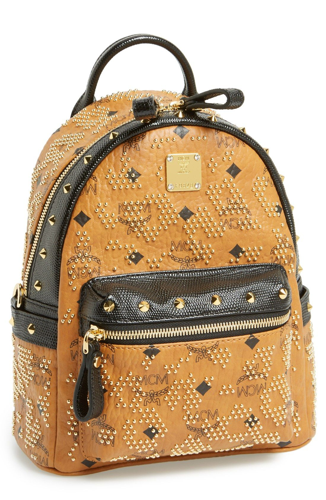 99540414 Got to love the gold studs on this MCM logo print backpack ...